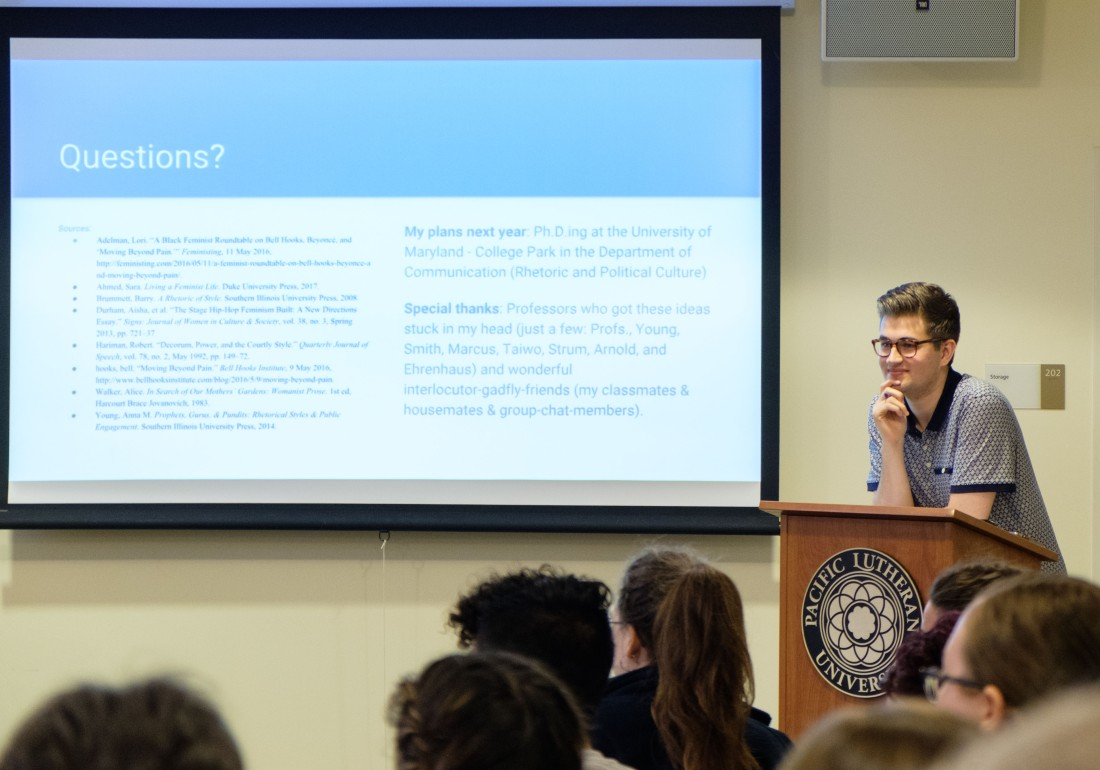 Matthew Salzano presenting his Women's and Gender Studies Capstone at Pacific Lutheran University, Thursday, May 24, 2018. (Photo: John Froschauer/PLU)
